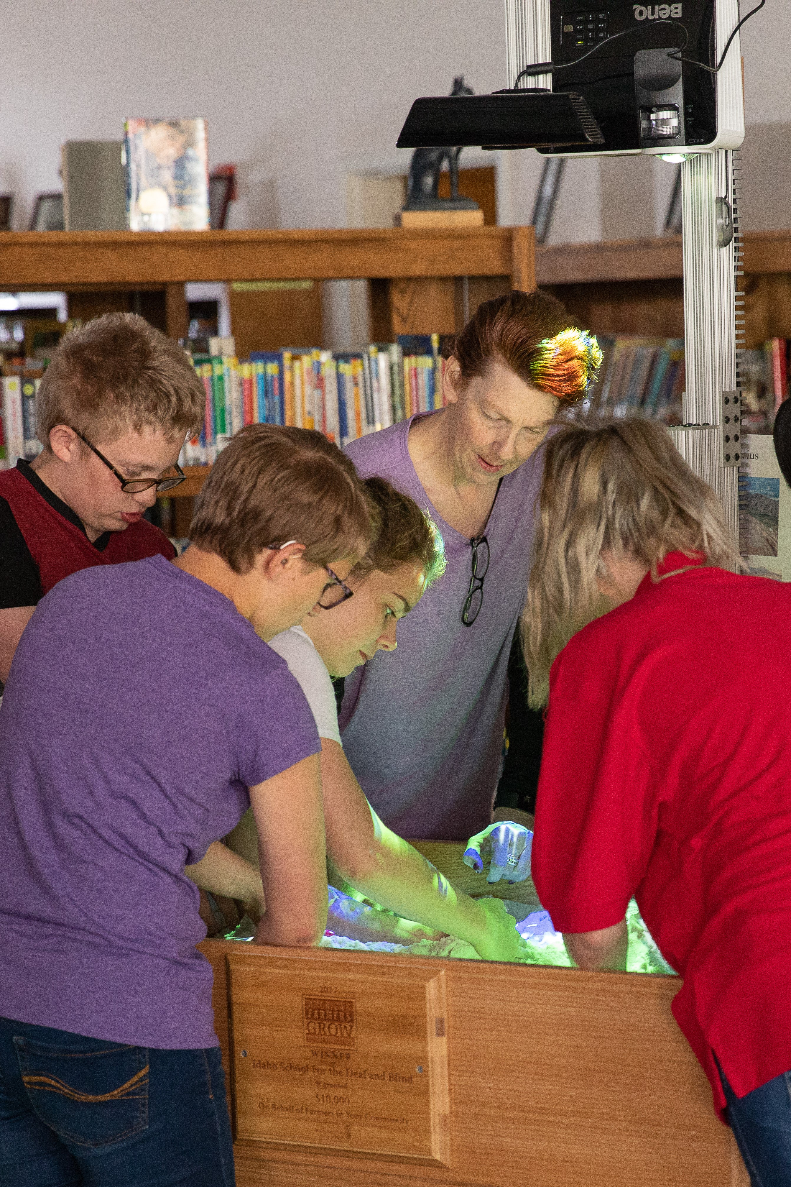 students explore with the augmented reality sandbox in the library